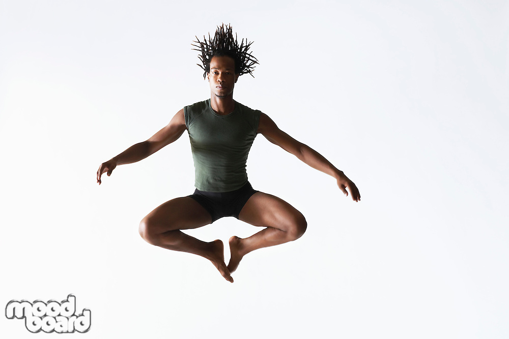 Ballet dancer leaping in mid-air