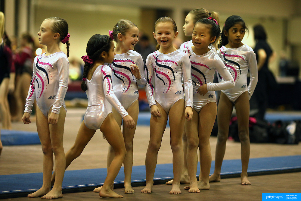 Young gymnasts share a joke during vault warm up before competition during the 21st American Invitational 2014 competition at the XL Centre. Hartford, Connecticut, USA. USA. 31st January 2014. Photo Tim Clayton
