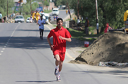 April 27, 2018 - Matan Anantnag, Jammu And Kashmir, India - DDC Anantnag Mohammad Younus Mallik flagged off nine Kilometers Marathon From Akad To Mattan Tick Bagh area of south Kashmirs Anantnag district  on 28,April,2018 Hundreds Of Participants From Different Parts Of Anantnag Participated. (Credit Image: © Aasif Shafi/Pacific Press via ZUMA Wire)