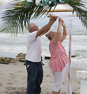 Tim and Cherie Richmond decorate the gazebo for their daughter Katie's wedding in Jupiter, Florida, on January 20, 2018.