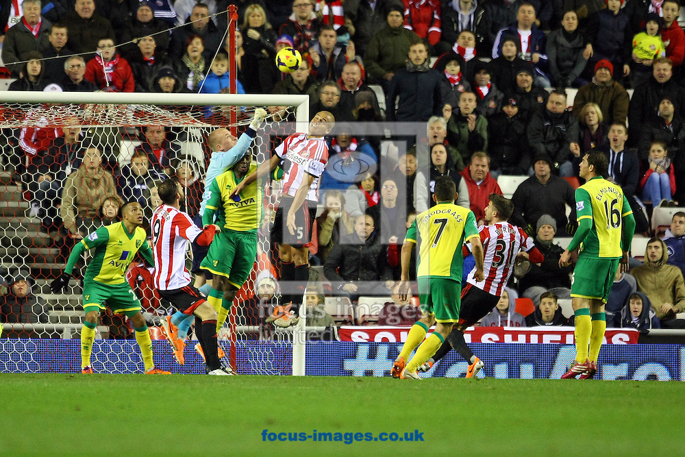 Picture by Paul Chesterton/Focus Images Ltd +44 7904 640267<br /> 21/12/2013<br /> John Ruddy of Norwich punches clear during the Barclays Premier League match at the Stadium Of Light, Sunderland.