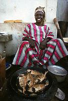 woman frying fish in Dakar