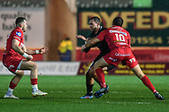 Ospreys' Ashley Beck is tackled by Scarlets' Dan Jones - Mandatory by-line: Craig Thomas/Replay images - 26/12/2017 - RUGBY - Parc y Scarlets - Llanelli, Wales - Scarlets v Ospreys - Guinness Pro 14
