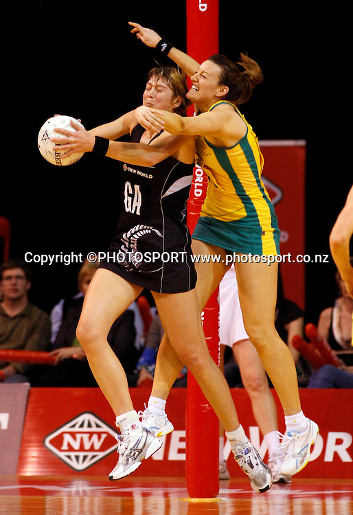 NZ GA Irene van Dyk gets to the ball ahead of GK Bianca Chatfield.<br />