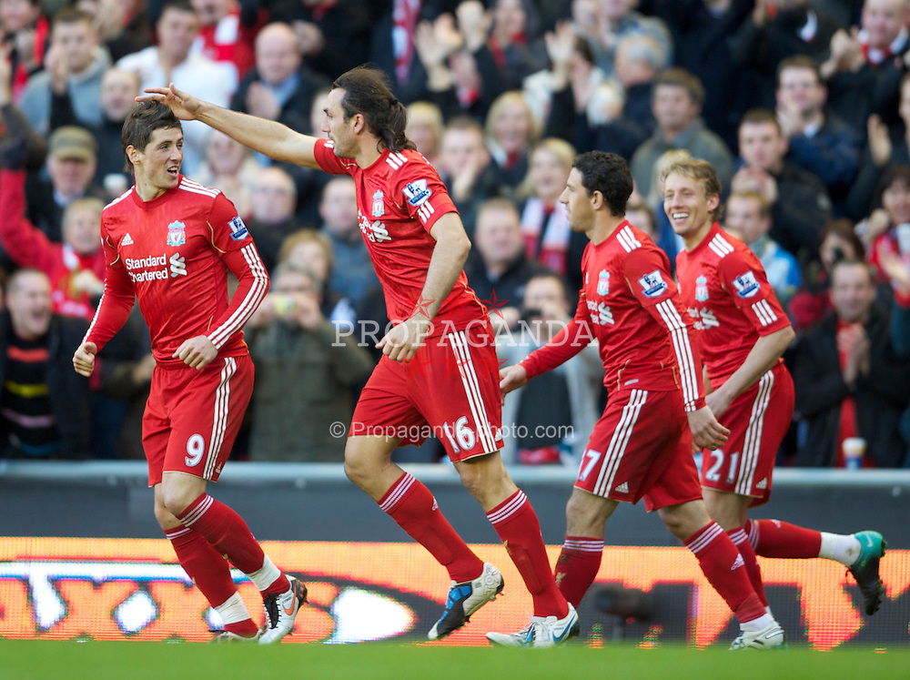 LIVERPOOL, ENGLAND - Sunday, October 24, 2010: Liverpool's Sotirios Kyrgiakos celebrates scoring the opening goal against Blackburn Rovers during the Premiership match at Anfield. (Photo by David Rawcliffe/Propaganda)