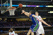 Brett Comer (0) of the Florida Gulf Coast University Eagles is hit on the arm by Erik Murphy (33) of the University of Florida Gators as he drives to the basket during the NCAA South Regionals at Cowboys Stadium in Arlington on Friday, March 29, 2013. (Cooper Neill/The Dallas Morning News)
