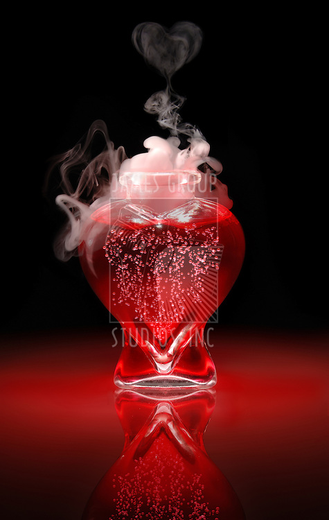 Open heart-shaped bottle of red, bubbling, smoking, love potion on a black background