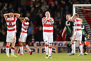 The Doncaster Rovers players can't believe that Doncaster Rovers forward Nathan Tyson has missed during the The FA Cup third round match between Doncaster Rovers and Stoke City at the Keepmoat Stadium, Doncaster, England on 9 January 2016. Photo by Simon Davies.