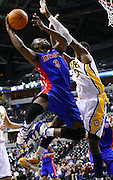 March 30, 2011; Indianapolis, IN, USA; Detroit Pistons point guard Rodney Stuckey (3) puts the ball up against Indiana Pacers center Roy Hibbert (55) at Conseco Fieldhouse. Indiana defeated Detroit 111-101. Mandatory credit: Michael Hickey-US PRESSWIRE