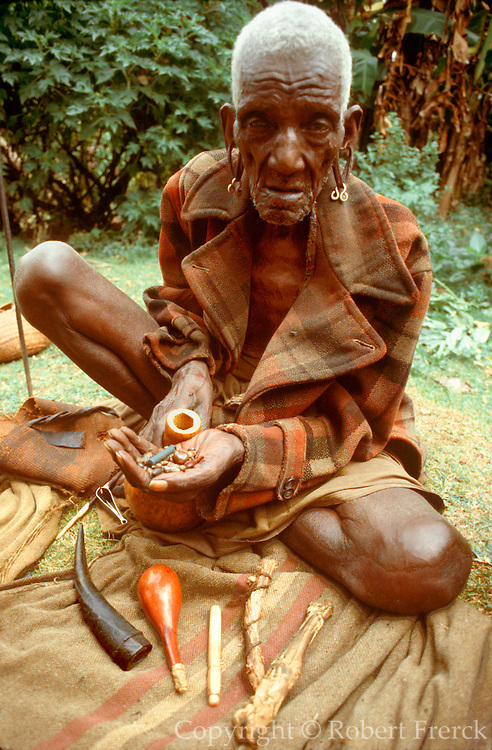KENYA, KIKUYU PEOPLE a shaman or witch doctor of the Kikuyu tribe displaying his mystical objects at his compound in the Kenyan highlands