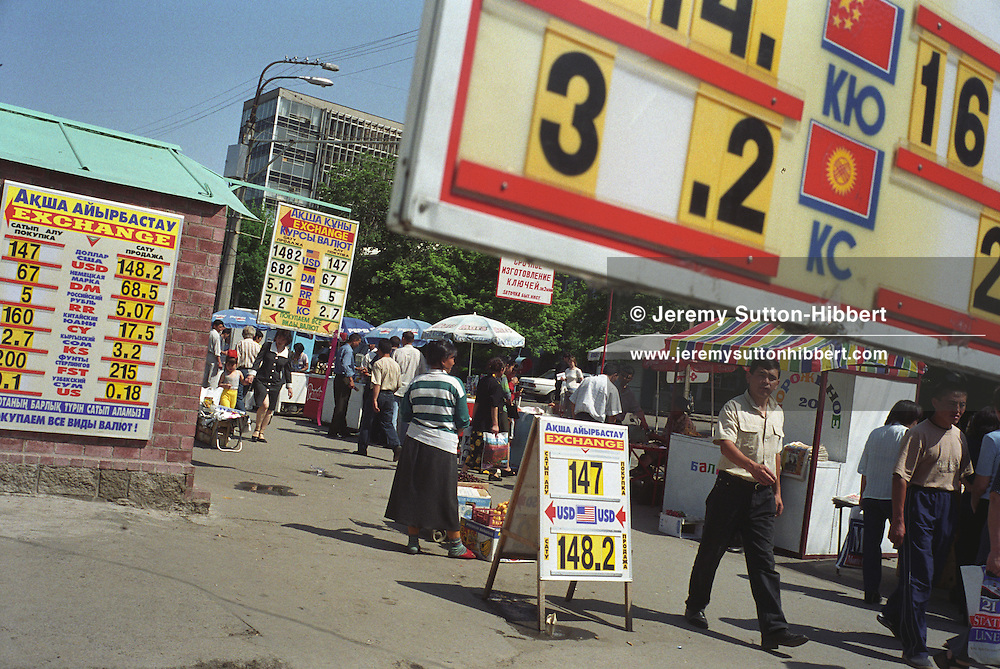 A street full of signs for currency exchange bureaus, in the capital city of Almaty. Almaty is a city on the rise, with much foreign investment, and plays host to many oil and gas companies, Kazakhstan being a rich country full of natural resources of oil, gas and minerals.