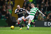 Dundee's James Vincent and Celtic's Leigh Griffith bettle for the ball - Celtic v Dundee in the Ladbrokes Scottish Premiership at Celtic Park, Glasgow. Photo: David Young<br /> <br />  - © David Young - www.davidyoungphoto.co.uk - email: davidyoungphoto@gmail.com