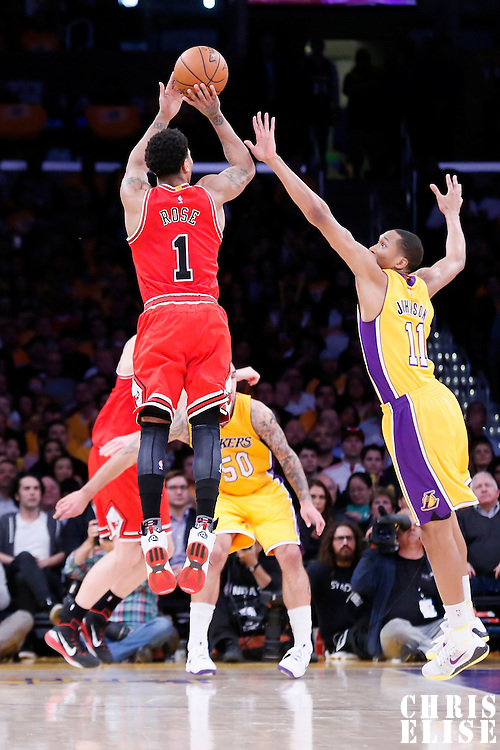 29 January 2015: Chicago Bulls guard Derrick Rose (1) takes a jump shot over Los Angeles Lakers forward Wesley Johnson (11) during the Los Angeles Lakers 123-118 2OT victory over the Chicago Bulls, at the Staples Center, Los Angeles, California, USA.
