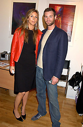 GEORGIE LEATHAM and MIKE PEMBERTON at an exhibition of art by Jeffrey Kroll entitled Imirage held at the Arndean Gallery, Cork Street, London on 19th October 2005.<br />