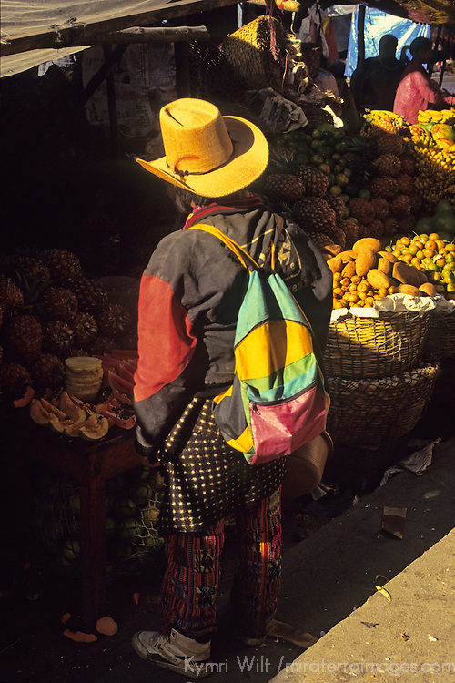 Central America, Latin America, Guatemala, Chichicastenango. Local man shopping for fruit at the Chichicastenango market.