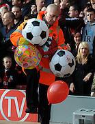A Liverpool Steward gets rid of a few beach balls. Liverpool v Manchester United 25/10/09.