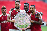 Arsenal forward Olivier Giroud (12), Arsenal forward Danny Welbeck (23), Arsenal forward Theo Walcott (14), Arsenal midfielder Alex Oxlade-Chamberlain (15) celebrate win during the FA Community Shield match between Arsenal and Chelsea at Wembley Stadium, London, England on 6 August 2017. Photo by Sebastian Frej.
