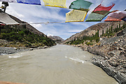 A view of the Indus River with prayer flags at Leh, Ladakh, Jammu and Kashmir. India.
