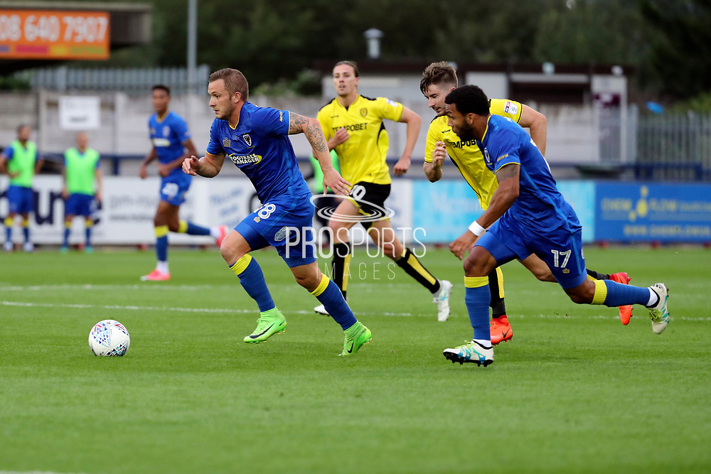AFC Wimbledon midfielder Dean Parrett (18) running through to score first goal during the Pre-Season Friendly match between AFC Wimbledon and Burton Albion at the Cherry Red Records Stadium, Kingston, England on 21 July 2017. Photo by Matthew Redman.