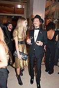 CARA DELEVIGNE; MATTHEW WILLIAMSON, Harper's Bazaar Women Of the Year Awards 2011. Claridges. Brook St. London. 8 November 2011. <br /> <br />  , -DO NOT ARCHIVE-© Copyright Photograph by Dafydd Jones. 248 Clapham Rd. London SW9 0PZ. Tel 0207 820 0771. www.dafjones.com.