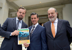 June 9, 2017 - Mexico City, DF, Mexico - Mexican President Enrique Pena Nieto, center, actor Leonardo DiCaprio and Mexican billionaire Carlos Slim discuss saving the Vaquita, a critically endangered porpoise native to Mexico's Gulf of California, at the presidential palace Los Pinos June 8, 2017 in Mexico City, Mexico. DiCaprio is joining forces with Pena Nieto and Slim to try and save the Vaquita from extinction. (Credit Image: © Julio Cesar Hernandez Reyes/Planet Pix via ZUMA Wire)