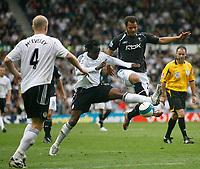 Photo: Steve Bond.<br />Derby County v Bolton Wanderers. The FA Barclays Premiership. 29/09/2007. Claude Davis (C) stretches to win the ball fron Daniel Braaten (R)