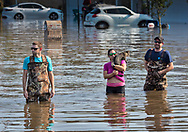 People rescuing a cat left behind in Vidor, Texas as the waters continued to rise following Hurricane Harvey.