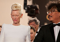 Tilda Swinton and Bong Joon Ho at the Okja gala screening,  at the 70th Cannes Film Festival Friday 19th May 2017, Cannes, France. Photo credit: Doreen Kennedy
