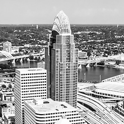 Panorama Cincinnati skyline aerial black and white picture of downtown city buildings, bridges, Ohio river, and sports stadiums. Panoramic picture ratio is 1:3.