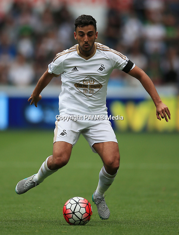 "Swansea City's Neil Taylor during the Barclays Premier League match at the Liberty Stadium, Swansea. PRESS ASSOCIATION Photo. Picture date: Saturday August 14, 2015. See PA story SOCCER Swansea. Photo credit should read: Nick Potts/PA Wire. EDITORIAL USE ONLY. No use with unauthorised audio, video, data, fixture lists, club/league logos or ""live"" services. Online in-match use limited to 45 images, no video emulation. No use in betting, games or single club/league/player publications."