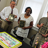 From left, retiring city employees Daniel Jimenez, who had 31 years with the Aberdeen Fire Department, Lottie Gladney, who had 25 years with the Aberdeen Police Department; and Ed Smith, who had 25 years with the Aberdeen Water Department, were honored with a retirement ceremony May 1 at City Hall. Jimenez's son toned out through the fire department's radio channel, thanking him for his years of service.