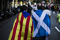 October 21, 2017 - Barcelona, Catalonia, Spain - Scotland and Catalan independent flag during the 450,000 protesters rally in Barcelona against the arrest of President of the Omnium Cultural Jordi Cuixart and president of the Catalan National Assembly Jordi Sanchez during the day that  Spain moves to impose direct rule 155 over Catalonia and arrest regions president as tensions threaten to boil over. Spain, Barcelona on October 21 of 2017. (Credit Image: © Xavier Bonilla/NurPhoto via ZUMA Press)
