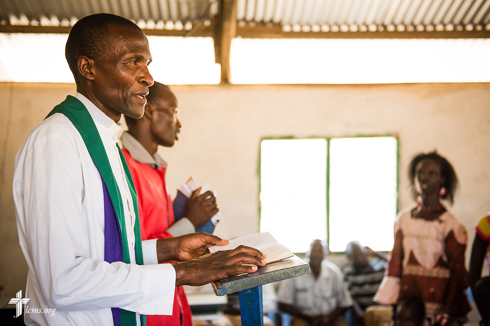 A pastor with the Evangelical Lutheran Church in Kenya leads worship at the Lokichar Lutheran congregation of the ELCK on Thursday, Oct. 15, 2015, in Lokichar, Kenya. LCMS Communications/Erik M. Lunsford