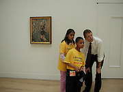 Mariya Bhukhun and Anton Peterson looking at Lucien Freud's most recent self portrait  with Nicholas Serota.. National Children's Art day. Tate. 13 June 2002. © Copyright Photograph by Dafydd Jones 66 Stockwell Park Rd. London SW9 0DA Tel 020 7733 0108 www.dafjones.com<br />