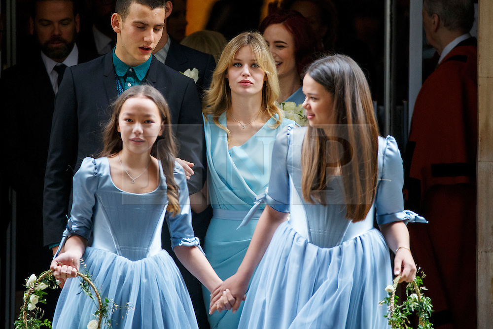 © Licensed to London News Pictures. 05/03/2016. London, UK. Bridesmaids Chloe Murdoch, Georgia May Jagger and and Grace Murdoch leaving Rupert Murdoch and Jerry Hall's wedding ceremony at St Bride's Church in Fleet Street, London on Saturday, 5 March 2016. Photo credit: Tolga Akmen/LNP