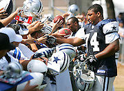 OXNARD, CA - AUGUST 17:  Defensive end Stephen Bowen #74 of the Dallas Cowboys signs autographs during Dallas Cowboys training camp on August 17, 2006 in Oxnard, California. ©Paul Anthony Spinelli *** Local Caption *** Stephen Bowen