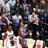 02 November 2016: Oklahoma City Thunder guard Russell Westbrook (0) goes for the layup past Los Angeles Clippers guard Chris Paul (3), Los Angeles Clippers center DeAndre Jordan (6) and Los Angeles Clippers forward Brandon Bass (30) during the Oklahoma City Thunder 85-83 victory over the Los Angeles Clippers, at the Staples Center, Los Angeles, California, USA.
