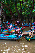 Women wait to give tourists boat rides through the flooded forest souyh of Kampong Phluk, Cambodia.