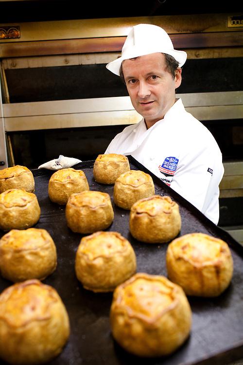 Stephen hallam demonstrates the process of making a Dickinson and Morris Pork Pie. Ye Olde Pork Pie Shoppe, Melton Mowbray
