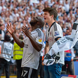 Aboubakar Kamara of Fulham celebrating at the final whistle with a fan