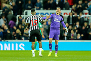 Martin Dubravka (#12) of Newcastle United congratulates Kenedy (#15) of Newcastle United following the Premier League match between Newcastle United and Watford at St. James's Park, Newcastle, England on 3 November 2018.