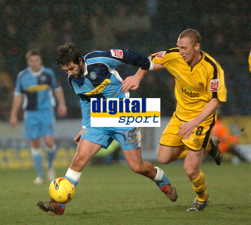 Photo: Tony Oudot.<br />Wycombe Wanderers v Notts County. Coca Cola League 2. 10/02/2007.<br />Tommy Doherty of Wycombe goes past Stephen Hunt of Notts County