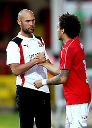 Swindon Town Head Coach Luke Williams shakes hands with Brandon Ormonde-Ottewill of Swindon Town - Mandatory by-line: Robbie Stephenson/JMP - 19/07/2016 - FOOTBALL - County Ground - Swindon, England - Swindon Town v Reading - Pre-season friendly
