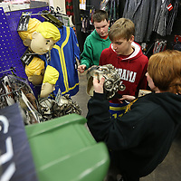 Chris Carlyle, 15, Erick Boren, 14, and Alyshia Carlyle, 21, shop for Halloween costumes on Monday at Spirit Halloween in Tupelo on Monday morning. Spirit Halloween has one more weekend to be open before Halloween.