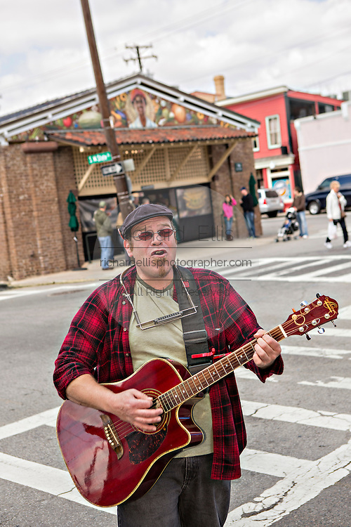 Glenn Orange plays guitar on the streets outside of the Historic Charleston City Market on Market Street in Charleston, SC.