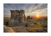 Sunset over sandstone rock formations and prairie of Medicine Rocks State Park, Montana.