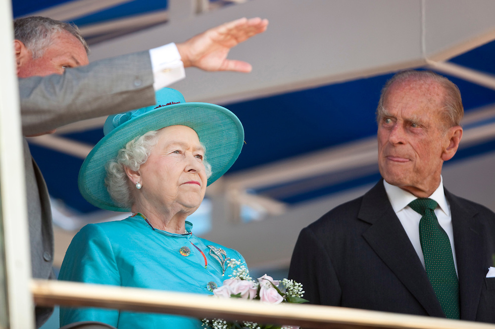 Queen Elizabeth II and Prince Philip, The Duke of Edinburgh speak with David Willmot, chairman of the Woodbine Entertainment Group prior to the running of the 151st running of the Queen's Plate at Woodbine racetrack in Toronto, Canada, July 4, 2010. <br /> AFP/GEOFF ROBINS/STR