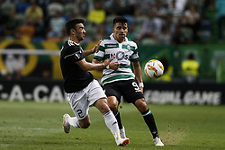 September 20, 2018 - Lisbon, Portugal - Gara Garayev of Qarabag FK (L) vies for the ball with Marcos Acuna of Sporting (R)  during Europa League 2018/19 match between Sporting CP vs Qarabagh FK, in Lisbon, on September 20, 2018. (Credit Image: © Carlos Palma/NurPhoto/ZUMA Press)