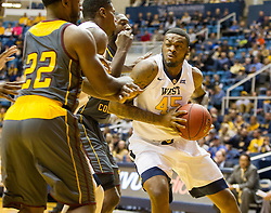 Nov 23, 2015; Morgantown, WV, USA; West Virginia Mountaineers forward Elijah Macon drives to the basket during the first half against the Bethune-Cookman Wildcats at WVU Coliseum. Mandatory Credit: Ben Queen-USA TODAY Sports