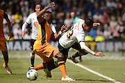 Hull City midfielder Moses Odubajo fouls Derby County midfielder Tom Ince during the Sky Bet Championship play-off first leg match between Derby County and Hull City at the iPro Stadium, Derby, England on 14 May 2016. Photo by Alan Franklin.